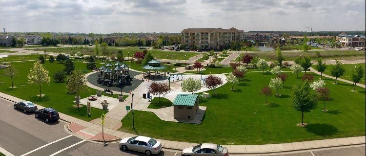Kelley Park View from Gabella 6 Panorama with trees, play equipment, shelter, and restrooms