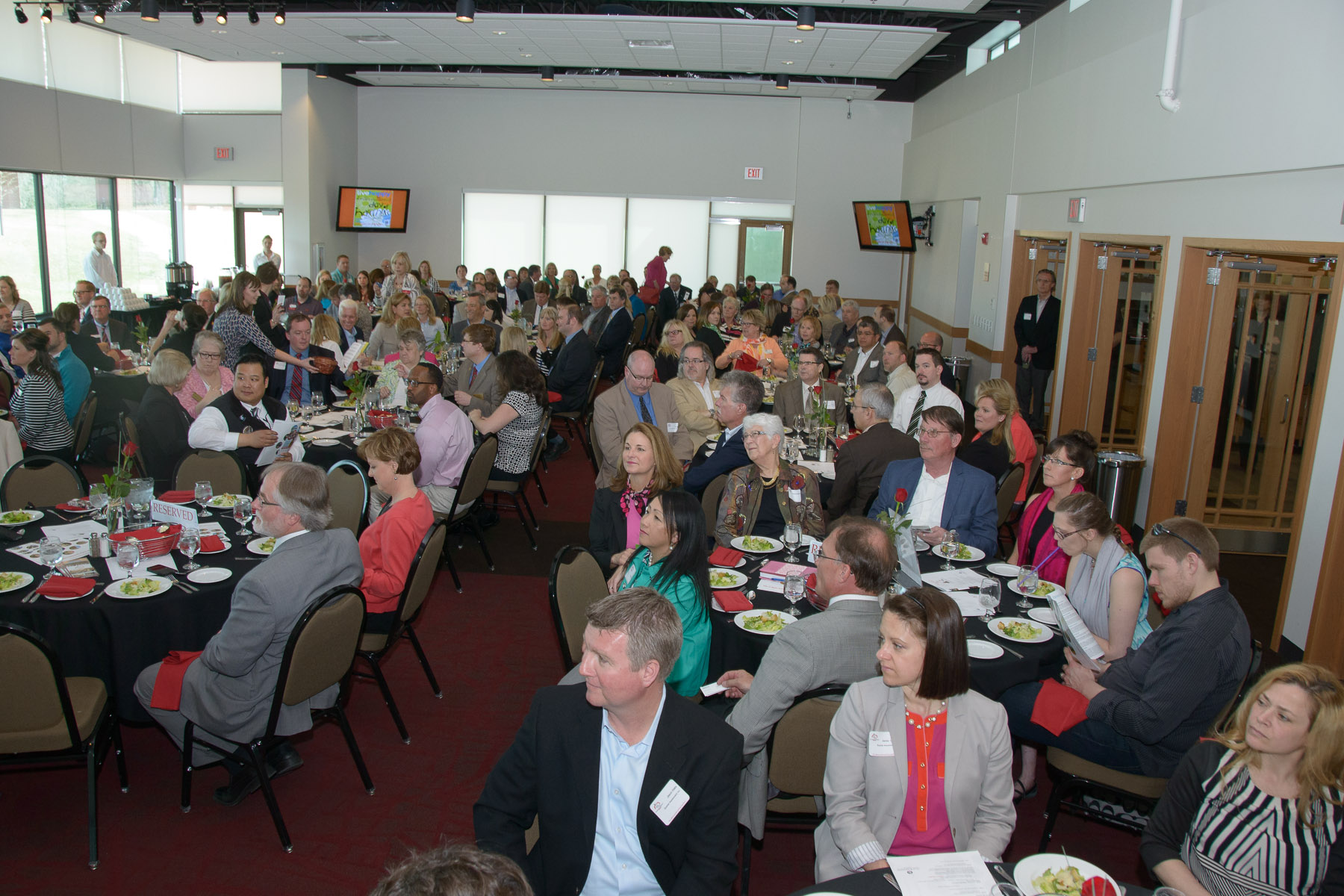 people sitting at luncheon tables