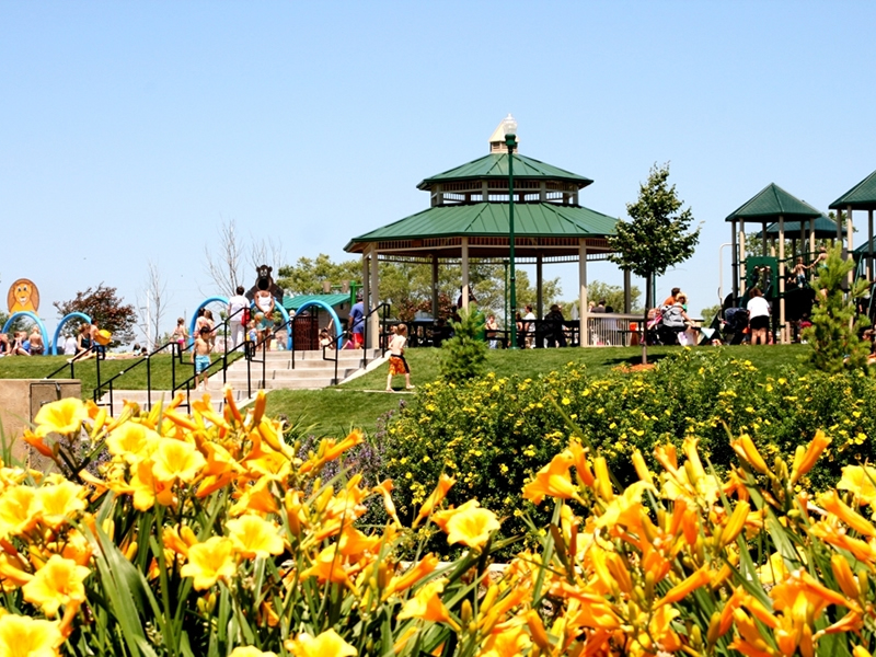 Park gazebo with flowers in foreground