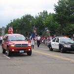 Police and Fire vehicles leading parade